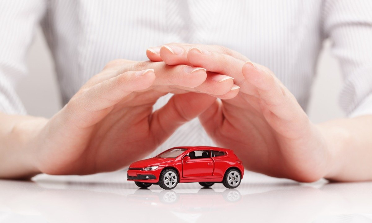 Hand Protecting Red Car