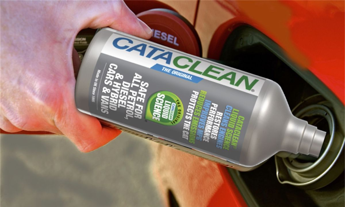 Man pouring fuel injector cleaner into car