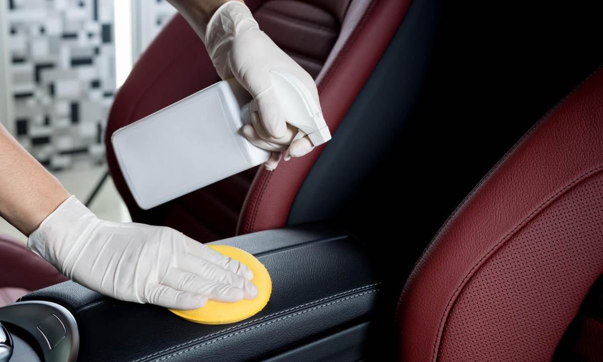 Woman applying best leather conditioner
