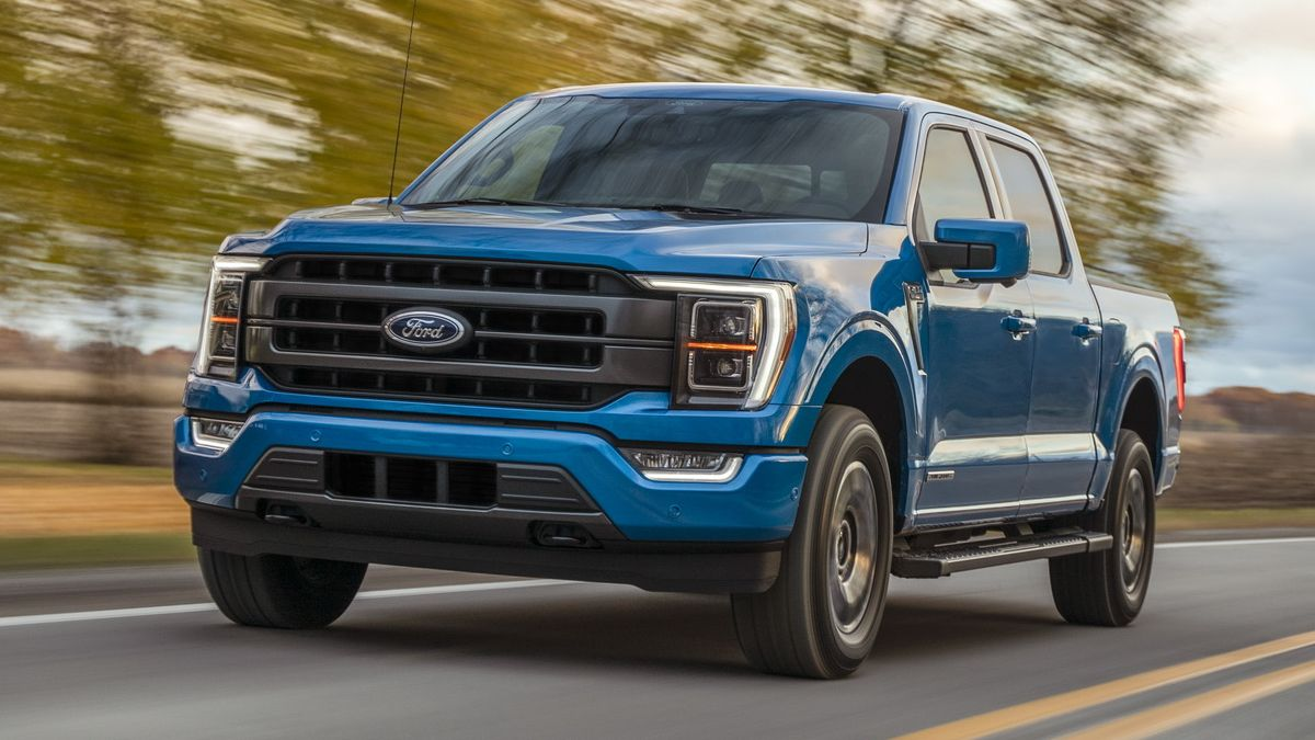 Blue Ford F-150 Hybrid Truck driving